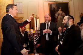 David Cameron, PM, lighting the Menorah candles